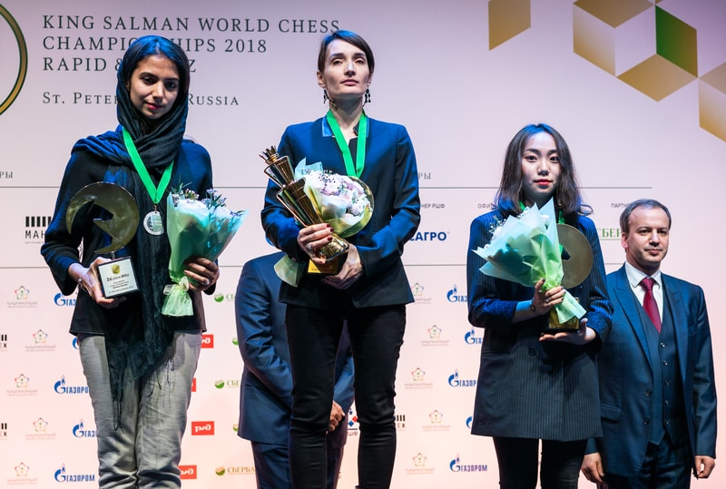 Winner of the Blitz Championship. From left silver Sarasadat Khademaisharieh , winner Kateryna Lagno & Tingjie Lei . Photo credit Lennart Ootes.