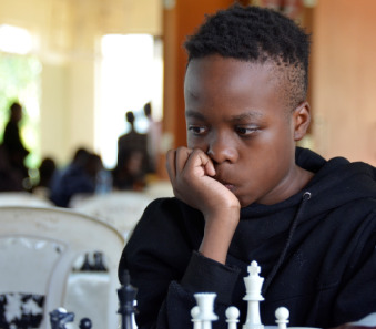 12 year old Odongo Lwanga in action who has a respectable 3 points out of 8 rounds.