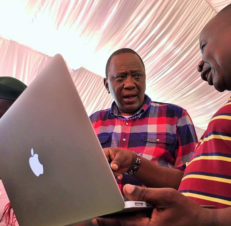 A visibly impressed H.E President Kenyatta is shown how the live transmission can be used to broadcast the game on the internet.