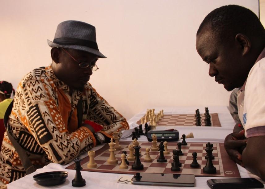 CM Alexis Ruzigura (left) from Rwanda in action against John Vianney Mukalzi.