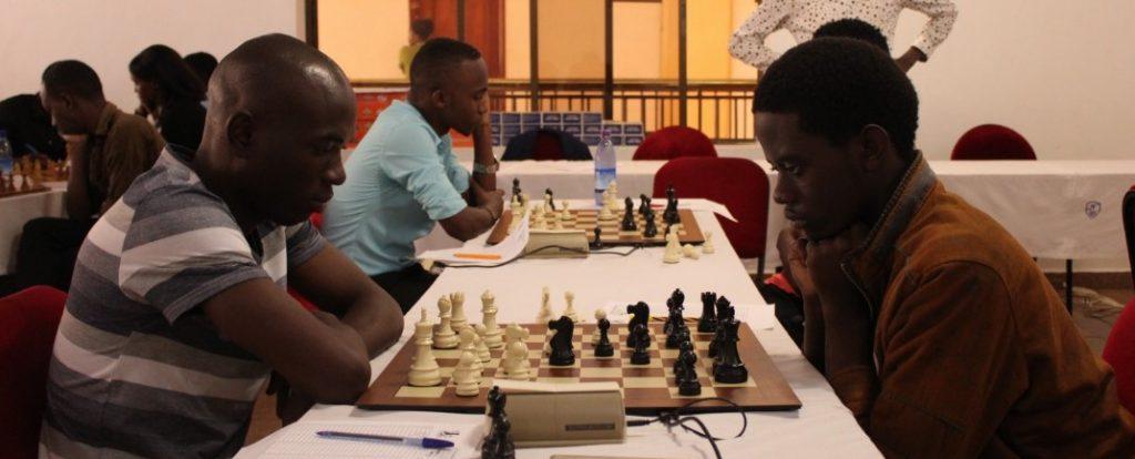 IM Elijah Emojong (left) takes on rising star Arthur Bitarinsa.