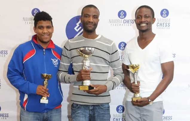 Winners in the U2000 section standing from left - CM Immanuel Gariseb (third place) of Namibia, Joster Kandangwe (winner)of Zambia in the U2000 and Fishan Mwagomba (second place) of Malawi.