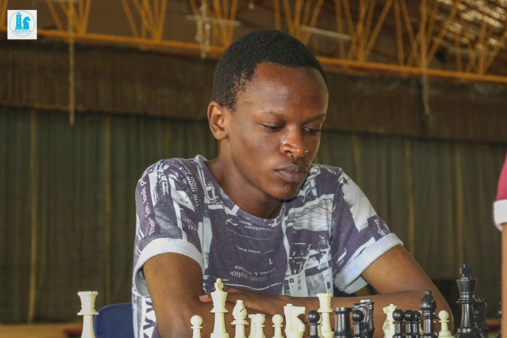 Milton Kihara in action.  Photo credit Lighthouse Chess Club.