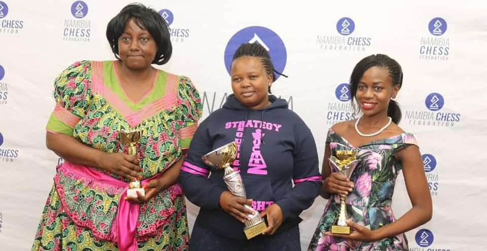 Winners of the Ladies Section. Standing from left WCM Rose Zeko of Zambia ( 3rd place), Constance Mbatha of Zambia (winner) & with Peninah Nakabo of Uganda (second place).