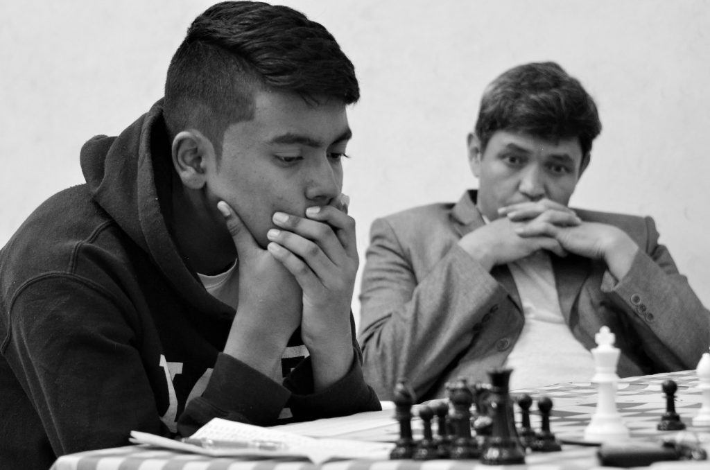 16 year old Sumit Deshpande in action while Meerabbas Afzali watches.