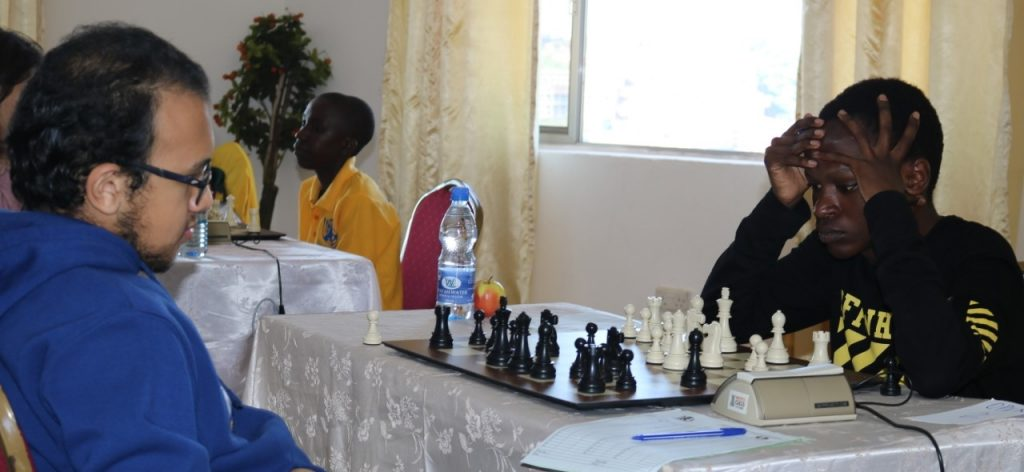 IM Fawzy Adham of Egypt (left) takes on Milton Kihara of Kenya in a game that he won.
