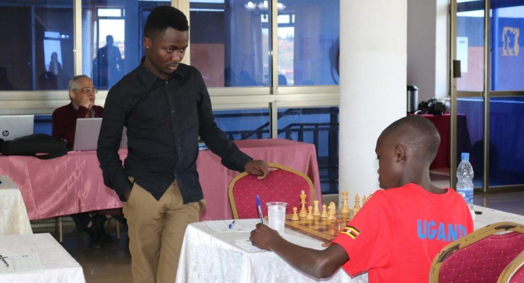 James Kabui stands over his opponent Victor Kanyike of Uganda. Photo credit James Sean Kang'aru.