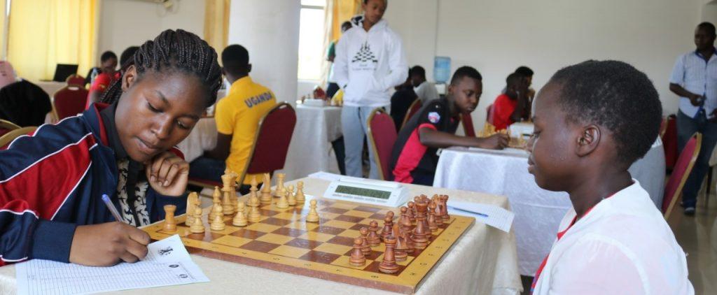 Cynthia Awino (left) of Kenya taking on Sarah Nakalyowa of Uganda. Photo credit James Sean Kang'aru.