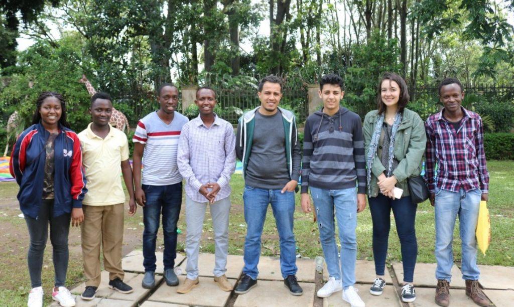 Gens una sumus - standing from left Cynthia Awino Obondo, James Kabui, James Mwangi, HAssan Ali (Somalia), Monday Koddowl Meldi (Algeria), FM Dfabri Massinas (Algeria), Amina Benelfekir (Algeria) and Milton Kihara.