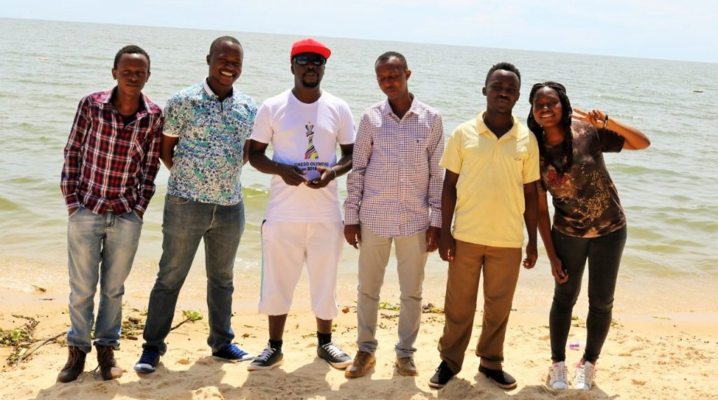 Players and officials pose at White Sands Beach, Entebbe. Photo credit James Mwangi.