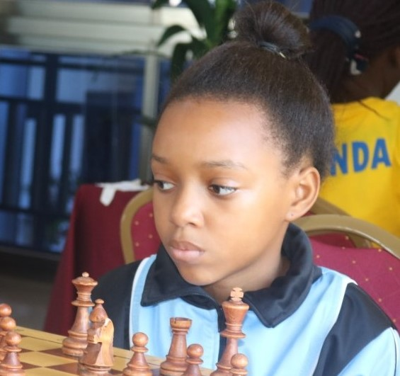 The star from Botswana – 13-year old WFM Naledi Marape seen in action here during the 2018 African Junior Chess Championship in Kampala, Uganda. Photo credit James Mwangi.