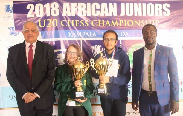 The winners pose with their trophies. Standing from left IA Hassan Khaled, WIM Anika Du Plessis, IM Fawzy Adham of Egypt., & President of Uganda Chess Federation Emmanuel Mwaka. Photo credit FIDE website.