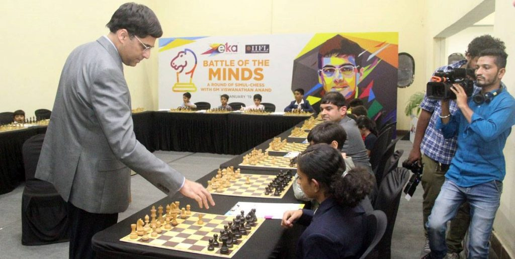 GM Anand plays a simultaneous against 18 juniors.