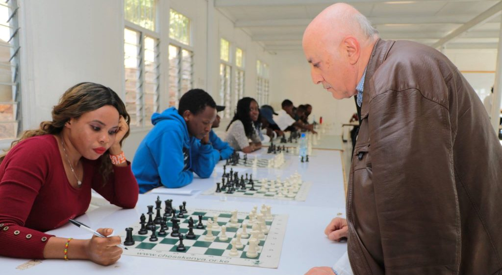Francisca Kagwiria in her game against GM Slim Bouaziz.  Photo credit Allan Rongoey.