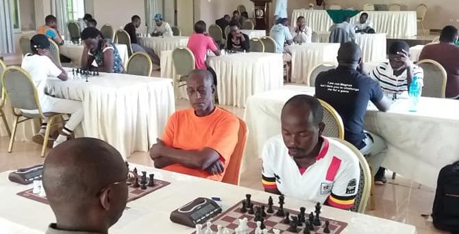 Action from the 2019 Rwanda Open. Joseph Kaamu (orange shirt) and Jonah Byaruhanga Jonah both of Uganda.