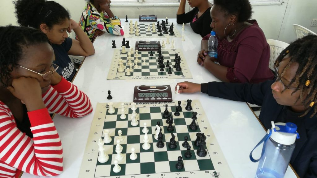 Gloria Jumba (red/white stripes) takes on Lucy Wanjiru and on the next board WFM Riya Shah (left) takes on WCM Joyce Nyaruai.