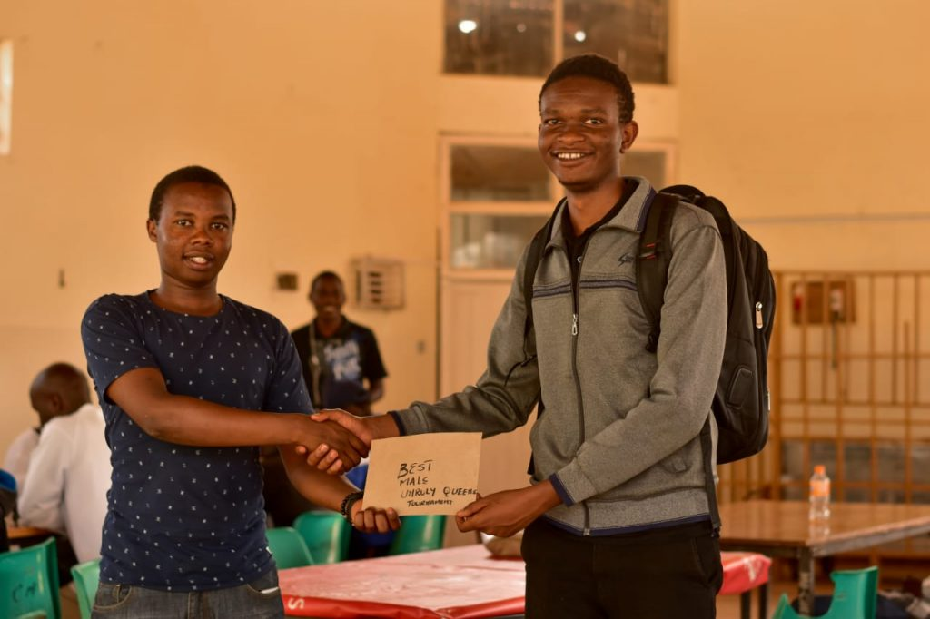 Evanson Kihara (right) receives his prize for winning the tournament.  Photo credit Instagram - hashtagphotographykenya.