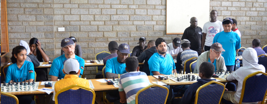 Nairobi Chess Club in their traditional blue uniforms against NACHA Kings. From left Pranjah Parikh, Mushfig Habilov, Maxwell Juma, Vasanth Ramesh & Peter Gilruth.