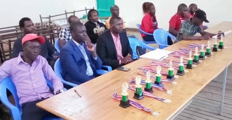Prize giving ceremony.  From left Ombima Meshack of Lamplighter School, Paul Eseme of Kitale School  and Benard Wanjala President of Chess Kenya.