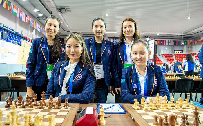 Team Kazakhstan at the Batumi Olympiad, standing from left WFM Serikbay Assel, Dinara Saduakasova, Gulmira Dauletova,. Stiing from left Guliskhan Nakhbaeva and Zhansaya Abdumalik. Photo credit David Llada.