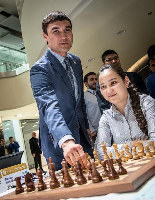 Serik Sapiyev making the ceremonial first move for former World Junior Champion Zhansaya Abdumalik of Kazakhstan.