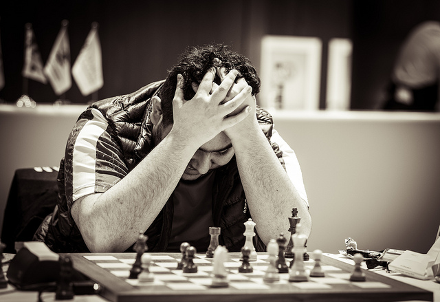 World Junior Chess Champion - Parham Maghsoodloo of Iran holds in head in agony when he let Rinat Jumbayev of Kazakhstan to escape with a draw. Photo credit David Llada.