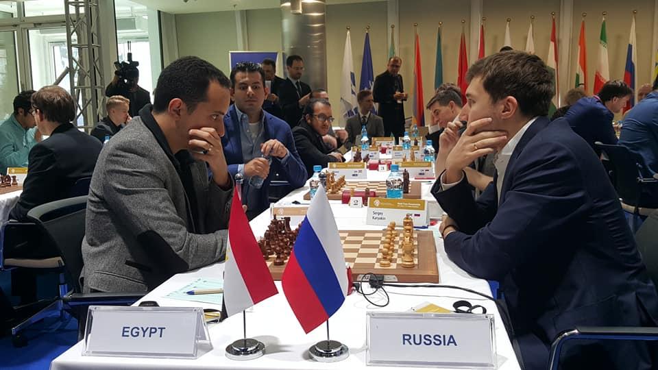GM Bassem Amin v GM Sergey Karjakin of Russia. Photo credit Dastan Kapaev.