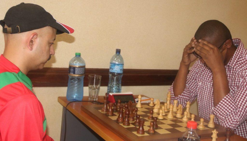 Mehul Gohil (left) in action against Ben Nguku. Photo credit James Mwangi.