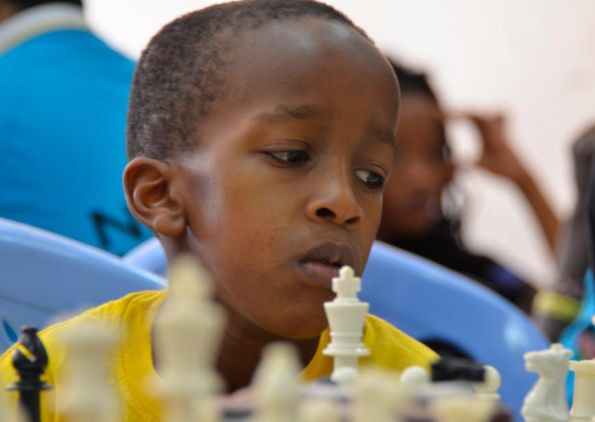 Juniors striking terror! Danwillies Muchiri of Lighthouse Chess Club in action.