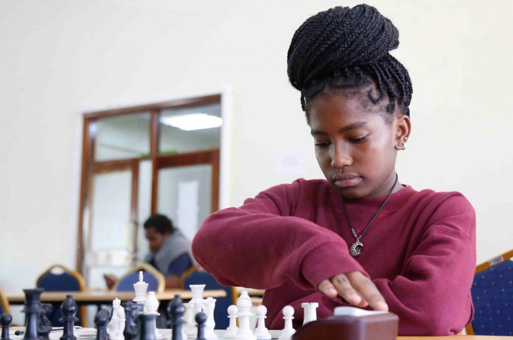 Gilliane Titi Otieno in action in the Junior section. Photo credit Chess Kenya.