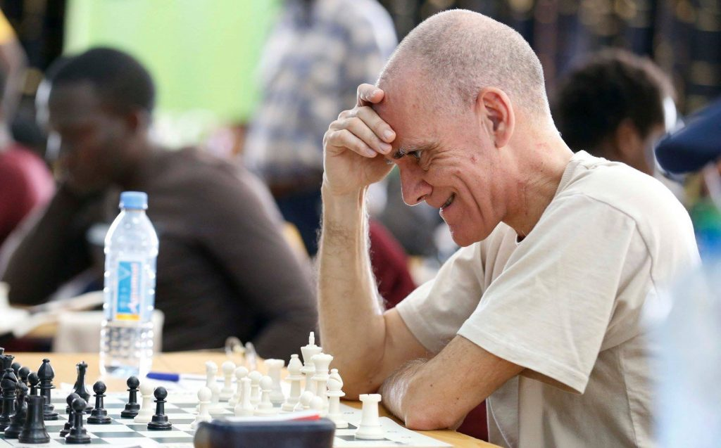Roberto Villuela of Nairobi Chess Club clearly not happy with his position!  Photo credit Chess Kenya.