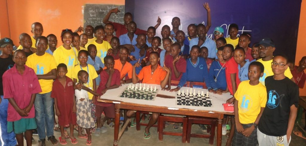 Friends for life!  Photo of students from Uganda School for the Deaf and players from Lighthouse Chess Club.  Photo credit James Mwangi.