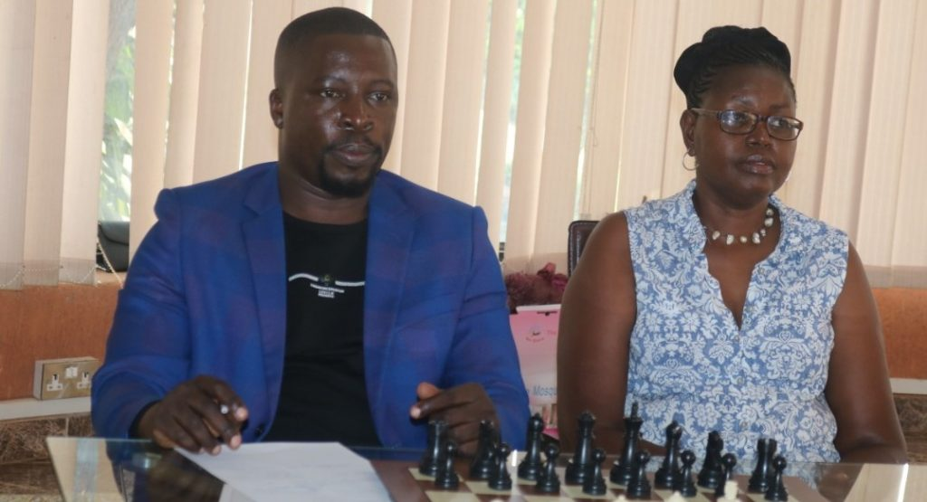President of Uganda Chess Federation Emmanuel Mwaka and Judy Kiragu of Lighthouse Chess Club.  Photo credit James Mwangi.