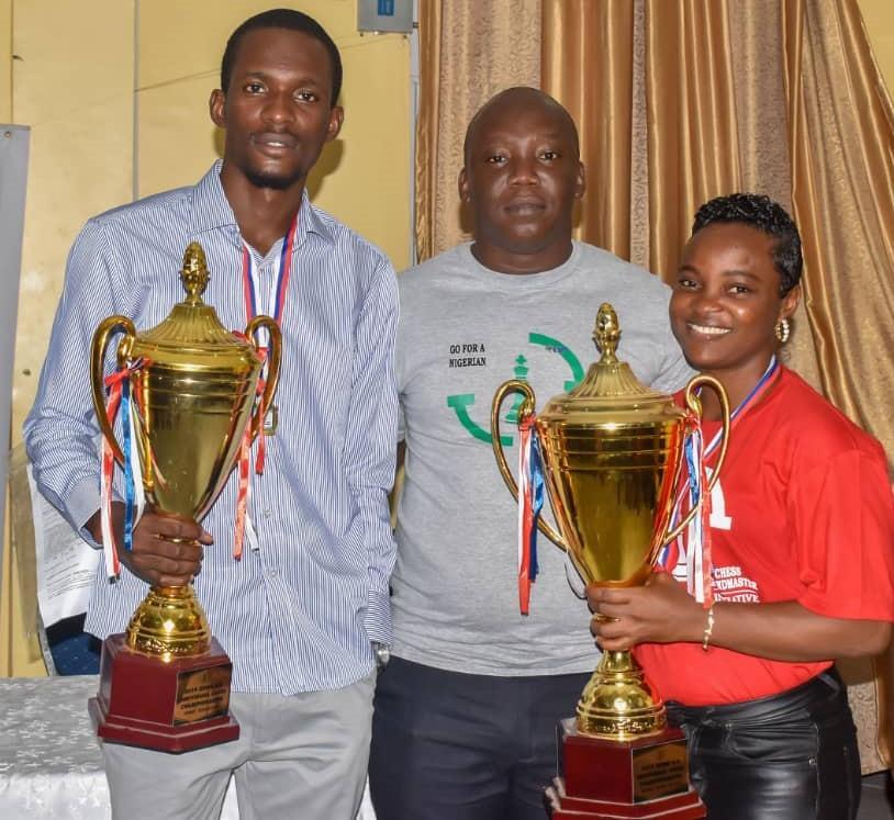 Winner of Open section FM Daniel Anwuli & Ladies Section Ofowino Toritsemuwa pose with Austin Apemiye (centre). Photo credit Ghana Chess Association.