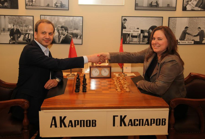 FIDE President Arkady Dvorkovich and Judith Polgar pose with the historic chess set. Photo credit FIDE.