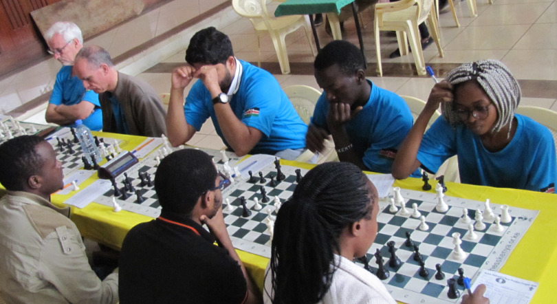 Nairobi Chess Club with their distinctive blue uniforms. From left Peter Gilruth, Roberto Viluella, Maxwell Juma and Glenda Madelta. Photo credit Kim Bhari.