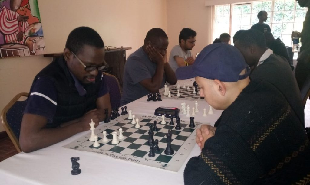 Photo from the event. Akello Atwoli (left) takes on Mehul Gohil.