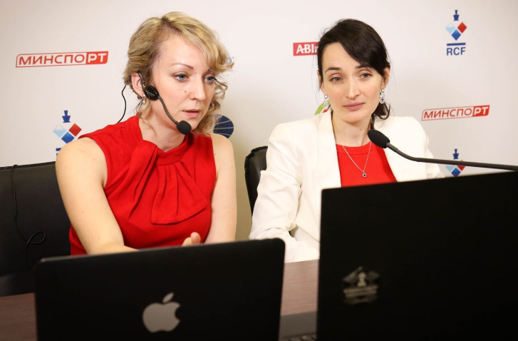Charming ladies in red. Commentator WIM Elisabeth Paehtz of Germany and contestant GM Kateryna Lagno of Russia. Photo credit https://fwct2019.com