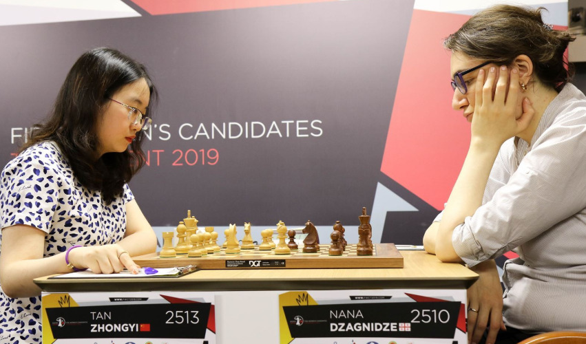 Tan Zhongyi of China versus Nana Dzagnidze of Georgia. Photo credit https://fwct2019.com.