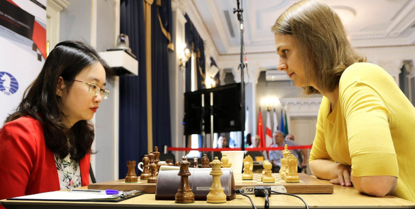Tan Zhongyi versus Anna Muzychuk. Photo credit Anastasiya Karlovych and Eteri Kublashvili.