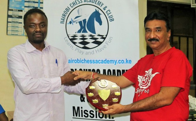 Joseph Methu (left) receives his prize from Ameet Parikh.
