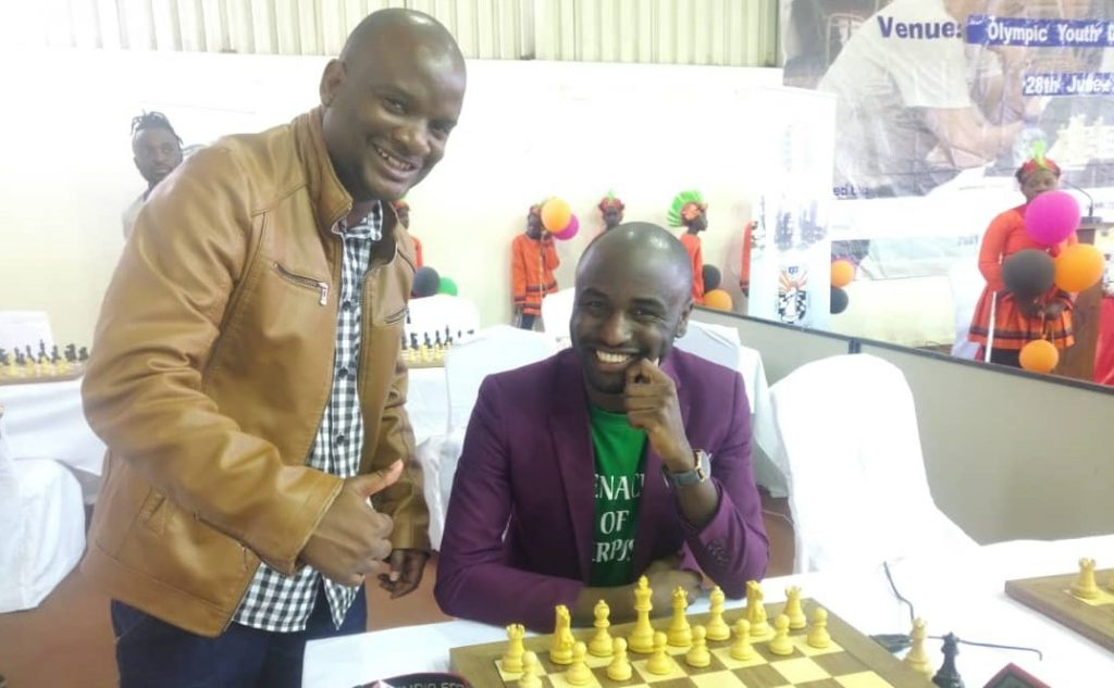 Makhosi Makhisho Nyirenda aka 'Khisho' (standing) poses with Prince Daniel Mulenga.