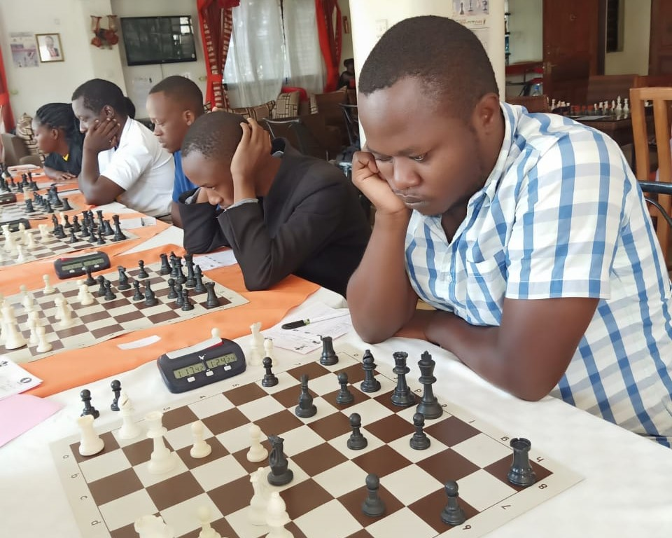 Section of the playing hall. Andrew Owili (with white/blue shirt) of Victoria Chess Club in action.
