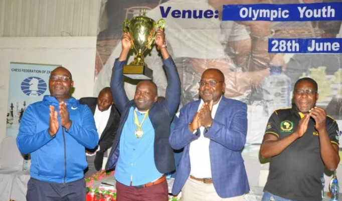 IM Richmond Phiri lifts the winning trophy of the 2019 Zambia Open.