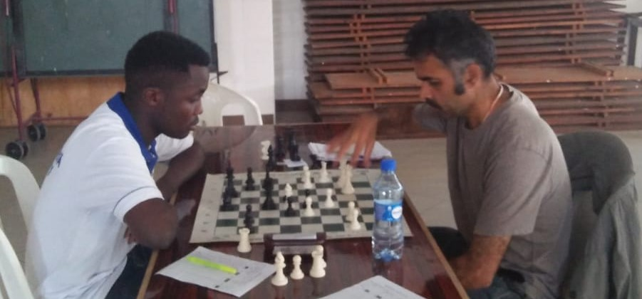 James Kabui (left) takes on Sajid Nurmohamed in a game that ended in draw.