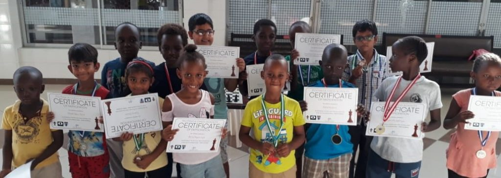 Participants of the Junior section pose with their certificates.