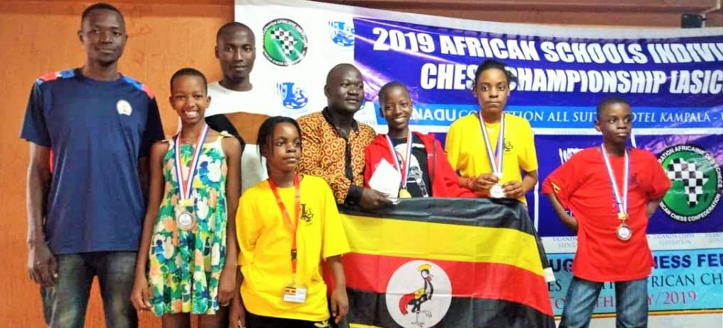 Prize winners from Uganda pose with their medals.