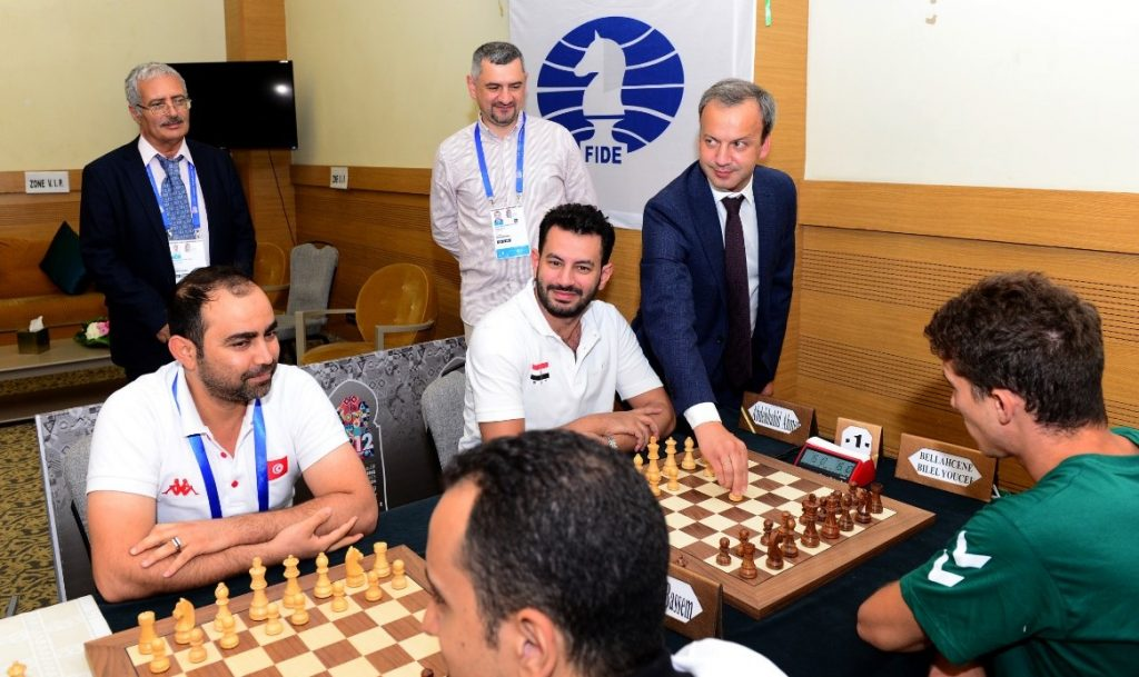 FIDE President Arkady Dvorkovich makes the ceremonial first move for GM Adly Ahmed of Egypt. Photo credit Mohamed Bounaji .