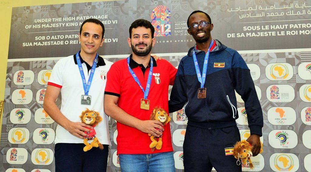 Prize winners in the Rapid Open section. From left GM Amin Bassem (silver), GM Adly Ahmed (gold) and FM Harold Wanyama of Uganda with the bronze medal. Photo credit Mohamed Bounaji .