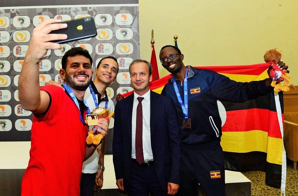 Proud winners pose with FIDE President Arkady Dvorkovich. Photo credit Mohamed Bounaji .